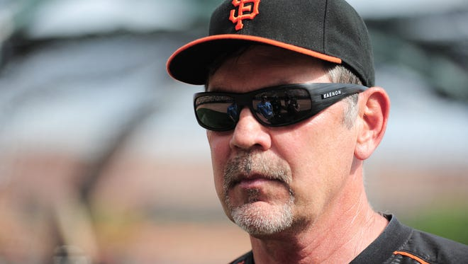 San Francisco Giants manager Bruce Bochy (15) looks on prior to facing the against the Chicago White Sox at Camelback Ranch in Phoenix on March 12, 2015.