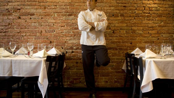 Bistro di Marino and Marino's Bistro To Go owner/executive chef Jimmy Marino leans against the brick wall of his Collingswood restaurant.