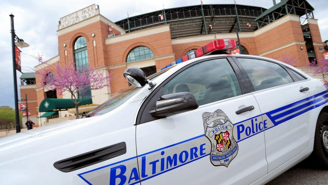A Baltimore police car sits outside the stadium prior to the cancellation of the game between the Chicago White Sox and Baltimore Orioles at Oriole Park at Camden Yards.