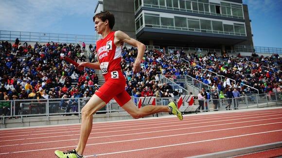 Lincoln's Nathan Schroeder runs the sprint medley event
