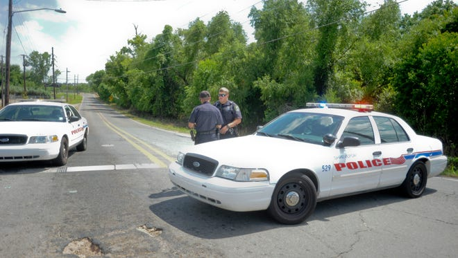 Russell Road was blocked off at Hilry Huckaby III Avenue as officers recovered the body of a deceased woman.