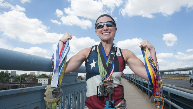 In November, marathon runner Katie Ross of Medford Lakes, will complete running a marathon in each of the 50 states. Thursday, July 23, 2015
