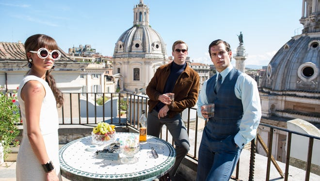 "ALICIA VIKANDER as Gaby Teller, ARMIE HAMMER as Illya Kuryakin and HENRY CAVILL as Napoleon Solo in Warner bros. Pictures' action adventure ""THE MAN FROM U.N.C.L.E.,"" a Warner Bros. Pictures release."