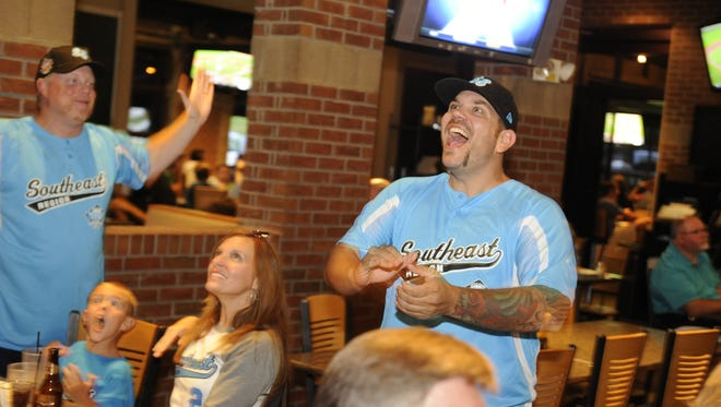 Brian Hall, left, and Craig Kacsmar, both South Nashville Little League board members, react to a play as they watch South Nashville in the Little League World Series in 2013. Little League has a strict background checking policy on any volunteer who works with the organization's teams.