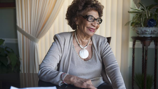 Riletta Cream, a former Camden County Freeholder and longtime educator in Camden, gave her second scholarship to area colleges. Here she looks through thank you letters written to her from scholarship recipients. Thursday, August 27, 2015