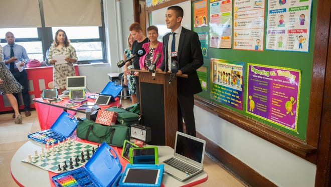 Camden School Superintendent Paymon Rouhanifard announces a $250,000 matching grant that could bring up to a half-million dollars in supplies and 'experiences' to city students during a press conference at Harry C. Sharp Elementary School on Wednesday.