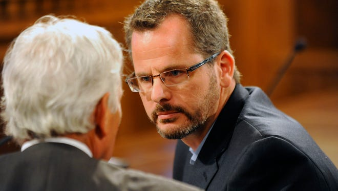 State Rep. Todd Courser talks with attorney Daniel Randazzo as the  House Select Committee breaks to go back to caucus and the house session Capitol Wednesday 9/9/2015.