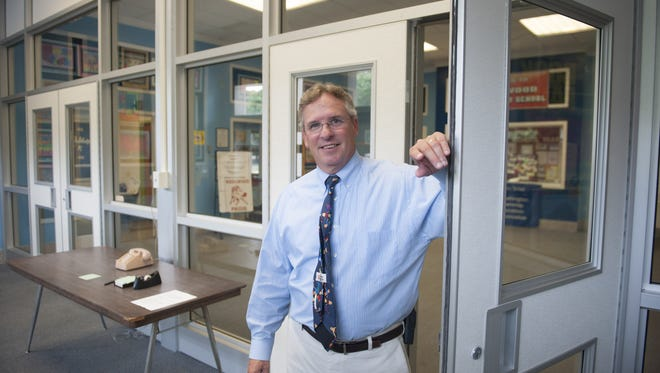 Wedgewood Elementary School Principal Mike Landon stands in the new secure vestibule at the Washington Twp. school. Washington Township just installed secure vestibules in entrances of 10 of 11 of the district's public schools in an effort to boost safety. Thursday, September 10, 2015