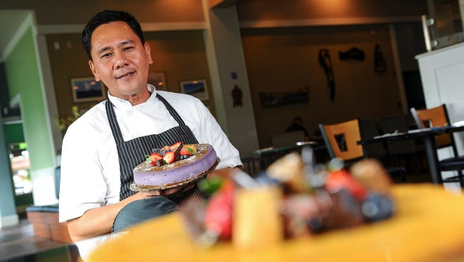 Executive Pastry Chef Raul Cordero poses for a photo with a taro cheesecake prepared at the Proa Restaurant in Hagatna on Friday, Sept. 11.
