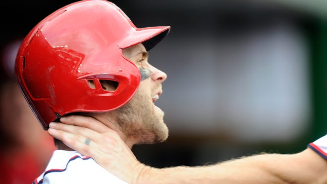 Bryce Harper is grabbed by Jonathan Papelbon in the eighth inning Sunday.