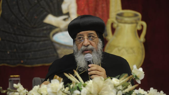 Pope Tawadros II addresses Coptic Christians at the St. Pishoy Coptic Orthodox Church in Antioch on Friday night.