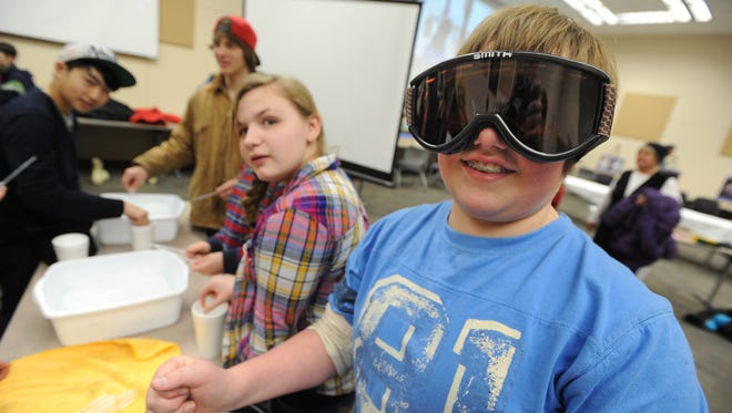 STEM Academy student Sullivan Langolf dons protective goggles in February 2014 to study how hot water can be used to drill through the arctic ice cap.
