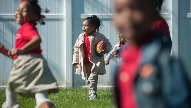 Kids including Alayah Merced (center) play outside at the Camden Day Nursery which celebrates its 125th anniversary on Oct. 24th.  Wednesday, October 21, 2015.
