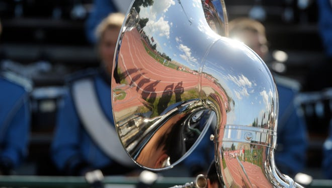 Members of the Lincoln band are reflected in Will Smith's tuba at Howard Wood Field. (Lara Neel/Argus Leader)