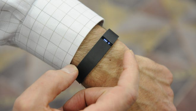 Las Vegas, NV, U.S.A  -- CES coverage -- For Jefferson Graham story -- Fitbit is showing off their new Flex which comes out this Spring.  The device keeps track of the wearer's daily physical activity.