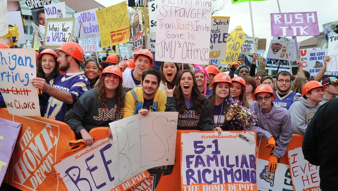 Oct 24, 2015; Harrisonburg, VA, USA; Students show off signs during the broadcast in the front of Wilson Hall on the campus of James Madison University prior to the homecoming game between Richmond and James Madison at Bridgeforth Stadium. Mandatory Credit: Brad Mills-USA TODAY Sports