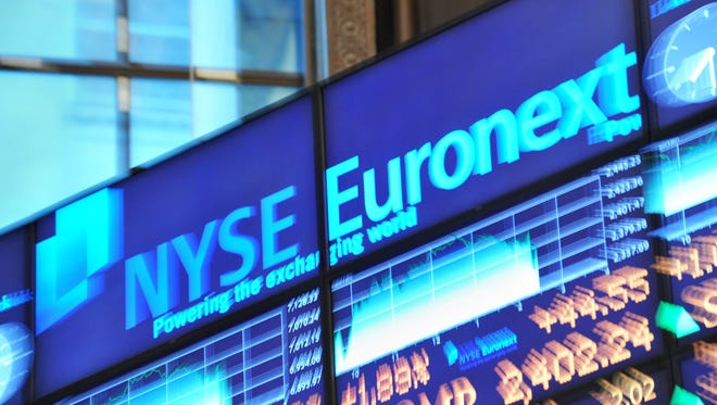 (A file picture taken on August 9, 2011 in New York shows an electronic billboard displaying prices at the New York Stock Exchange.