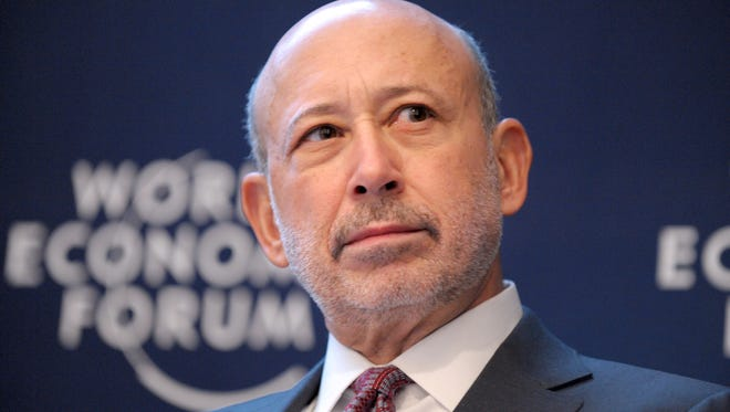 Goldman Sachs Group Chairman and Chief Executive Officer Lloyd C. Blankfein attends a session at the World Economic Forum in Davos, Switzerland, on Jan. 25, 2013.
