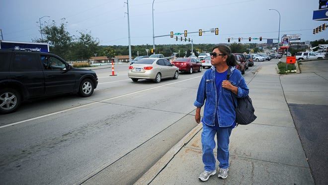 Donna Rose Peniska, who has been living on the streets for about five years, walks along East 10th Street near its intersection with Cliff Avenue Wednesday, Sept. 23, 2015, in Sioux Falls. Peniska, who has been arrested multiple times for trespassing, said that she's always afraid of getting a ticket for something.