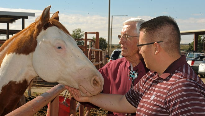 Associated Students of New Mexico State University President Dustin Chavez, right, spent a day in October shadowing NMSU President Garrey Carruthers. The day included a ribbon-cutting ceremony for the new therapeutic riding covered arena.