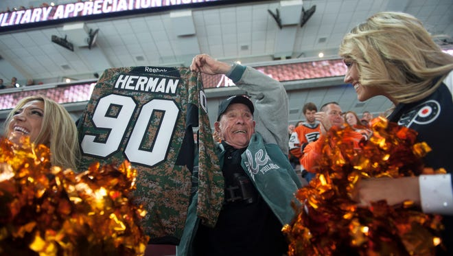 United States War World II Veteran and Purple Hearth Recipient Ralph Herman of Sewell,  smiles after getting honored and a standing ovation during a home Flyers game against the Colorado Avalanche .