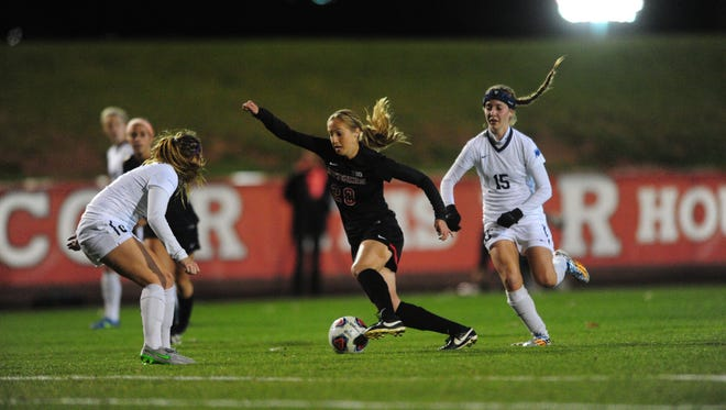 Rutgers forward Katelyn Walters dribbles around the Fairleigh Dickinson defense during Friday's NCAA Tournament match.