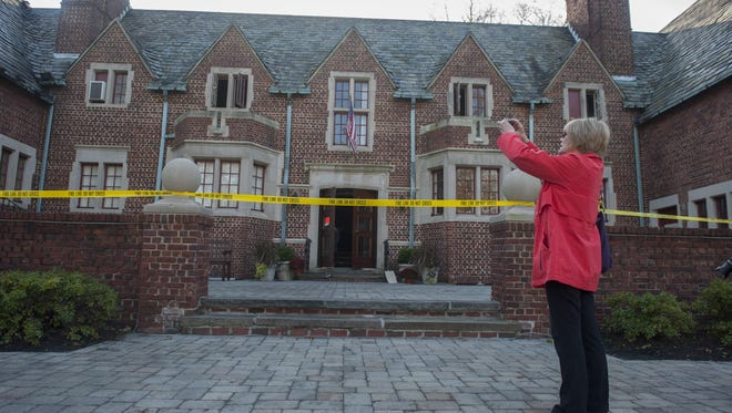 Cinnaminson resident Brenda Hahn, a volunteer at the National Alliance on Mental Illness -- whose office is inside the Moorestown Community Center -- takes a photo Wednesday of the damage caused by a fire.