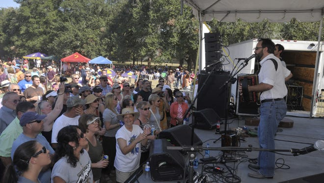 Roddie Romero plays before the crowd at Festivals Acadiens et Creoles, one of the popular free music events in Lafayette.