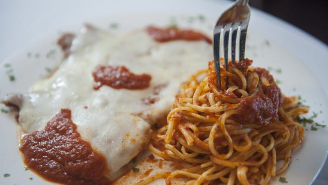 Italian-American classics, like this Chicken Parmesan entree, are big sellers at Carlucci's Waterfront in Mt. Laurel.