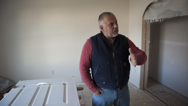 Gloucester County Habitat for Humanity Executive Director Tony Isabella visits the non-profit's first modular home site in Woodbury. They hope building modular homes will cut construction time from one year to about 2 months, and will cut the price per square foot by half. Wednesday, November 25, 2015.