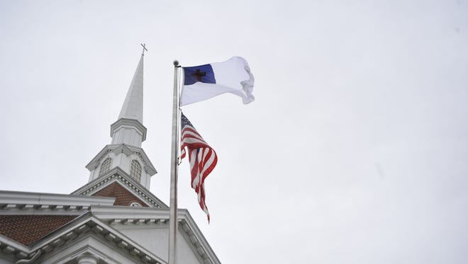 West Asheville Baptist Church has been flying the Christian flag above the American flag for about two months.