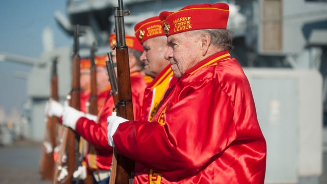 Members of the Marine Corps League look on after firing the 21 gun salute during the Pearl Harbor Day Commemoration aboard the Battleship New Jersey. Monday, December 7, 2015.