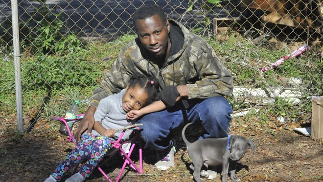 Johnathan Boykins and his daughter Armani. Boykins recently moved to Brownsville.