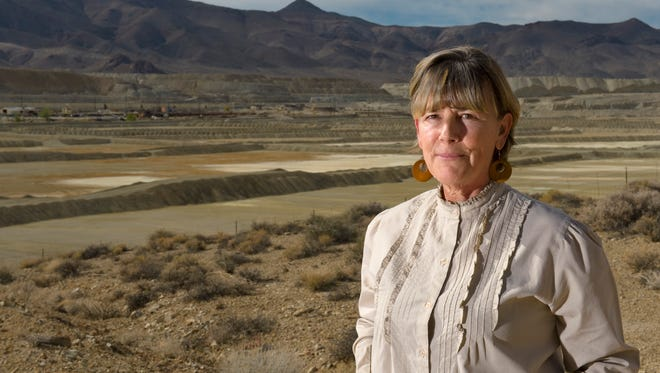 Peggy Pauly, who formed Yearington's first citizen advocacy group to address the water contamination from the former Anaconda copper mine site near Yearington, Nev., is pictured in front of the leach ponds that are responsible for most of that contamination Oct. 26, 2009. Fifteen years after U.S. regulators started assessing damage and health risks at an abandoned Nevada copper mine, the Environmental Protection Agency is moving to add the contaminated site to its Superfund National Priority List, according to documents obtained by The Associated Press.