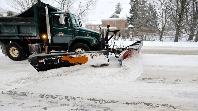 A plow clears Pearl Street in Burlington on Tuesday, December 29, 2015.
