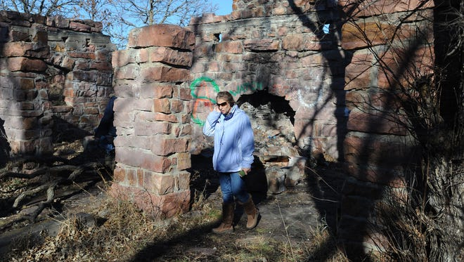 "Sandra Cheskey revisits the shelter in the Gitchie Manitou State Preserve in this photo shot on Wednesday, Nov. 13, 2013. Cheskey and four friends were hanging out when the Fryer brothers began to shoot at them 40 years ago at Gitchie Manitou State Preserve near Granite, Iowa. A book titled ""Gitchie Girl"" is to be released in 2016."