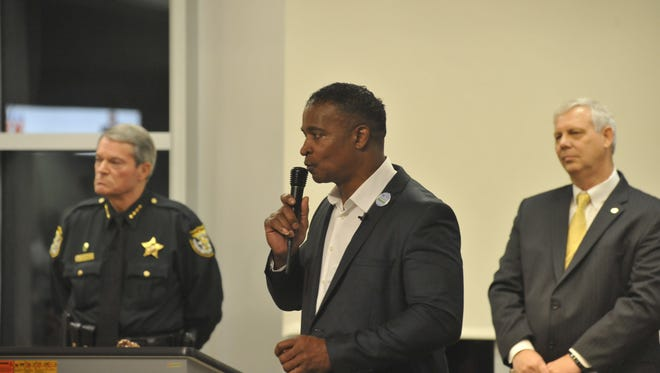 Flanked by his political competitors for sheriff  David Morgan on the left and John Johnson on the right, Doug Baldwin discusses his political platform at a forum in the West Florida Public Library in downtown Pensacola on Monday.