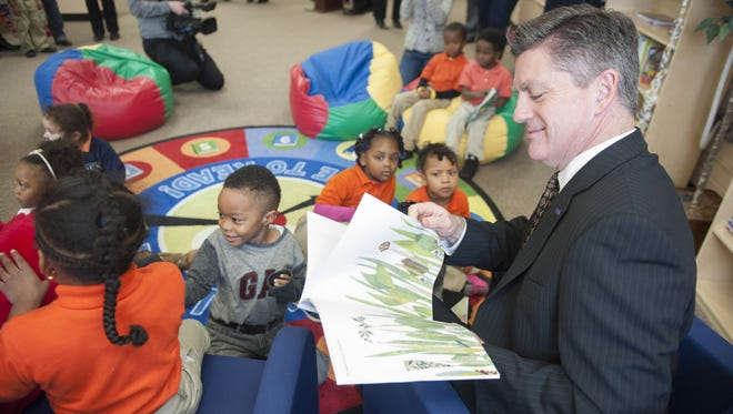 Jim Cawley, President and CEO of United Way of Greater Philadelphia and Southern NJ, reads to preschoolers in the region's first Club Connect Reading Oasis at Riletta Twyne Cream School in Camden.