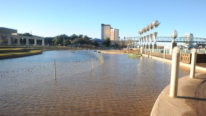 Riverview Park in Downtown Shreveport holds water as Red River stays only feet below minor flood stage. The park has been closed to the public.