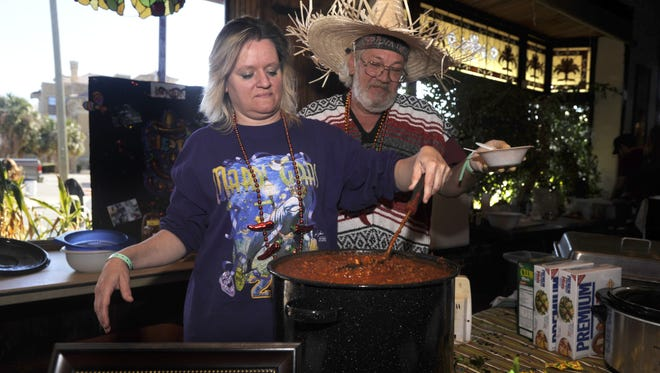 Carla Manning and Michael (MADDOG!) Adams prepare chili Saturday during the 2011 Great American Chili Cook-off at Seville Square.