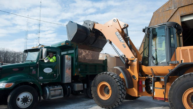 Salt is loaded into a plow truck at the Camden County Department of Public Works in Lindenwold in preparation for this weekend's storm. Thursday, January 21, 2016.