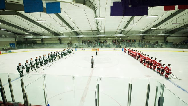 The teams line up to listen to the National Anthem during the boys hockey game between the Champlain Valley Union Redhawks and the Rice Green Knights at Cairns Arena on Saturday afternoon January 23, 2016 in South Burlington.
