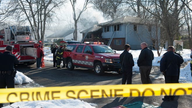 Firefighters and emergency personnel at the scene of a fire on Sheffield Rd. in Cherry Hill. Thursday, January 28, 2016.