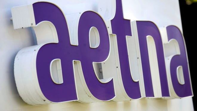 File photo taken in 2014 shows sign in front of Aetna's headquarters in in Hartford, Conn.