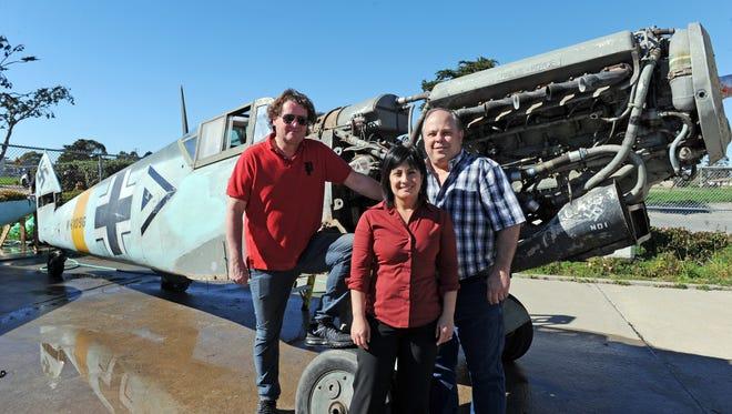 Owner Paul Boschung, left, Airmotive's David and Mari Teeters and the ME-109 at Salinas Municipal Airport on Monday.