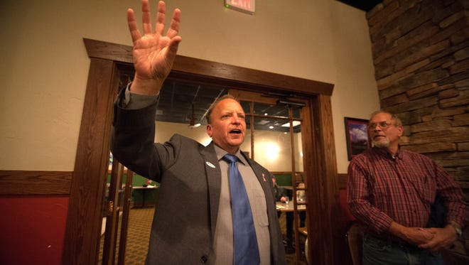 Dr. John Bizon addresses his supporters after winning the 62nd District in 2014.