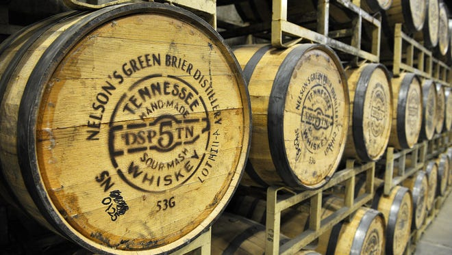In this file photo, white oak barrels hold what whiskey has been produced thus far at the Green Brier Distillery in Marathon Village on Nov. 12, 2014.