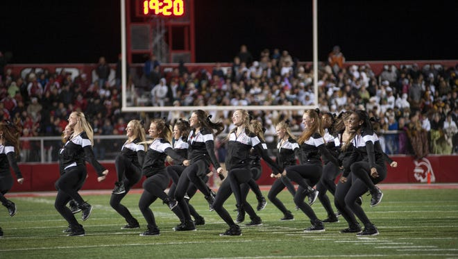 Center Grove dancers perform on Friday, Nov. 13, 2015, before Class the 6A semi-state playoff game against Avon High School.