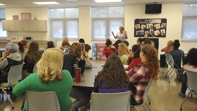 Laurie Rodgers, Executive Director for the PACE Center for Girls, talks to the students about role models and having an impact on the community.