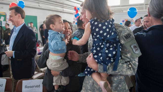 1LT Domenico Lazzaro of Holland, PA, is welcomed by his wife Myra and  kids Austin, 2, and Hunter, 4, during the welcome home celebration for 328th Military Police Company, New Jersey Army National Guard. Bordi is also a Camden County Police Officer. More than 120 Citizen-Soldiers of the 328th Military Police Company, New Jersey Army National Guard, were Welcomed Home by senior military leadership, friends and family at the National Guard Armory in Cherry Hill after a nearly yearlong mobilization to Guantanamo Bay, Cuba. Wednesday, March 16, 2016.